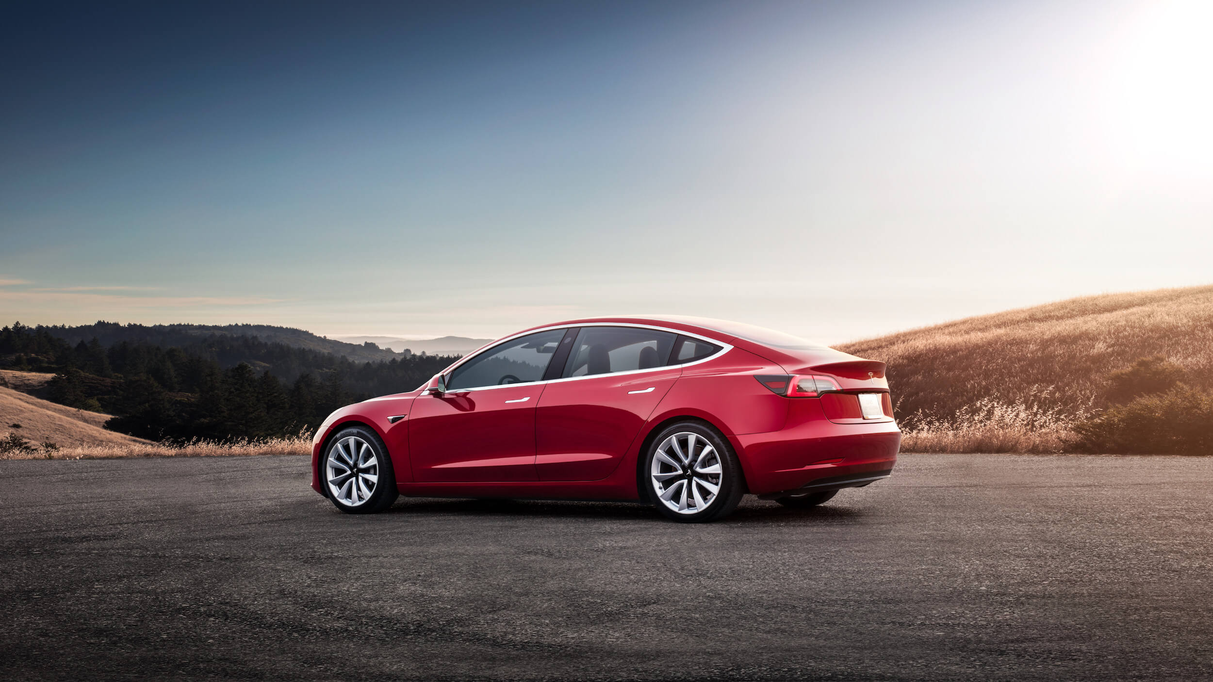Rode Tesla Model 3 profiel